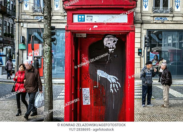 Old london style phone booth with graffiti in Santo Ildefonso district of Porto city on Iberian Peninsula, second largest city in Portugal