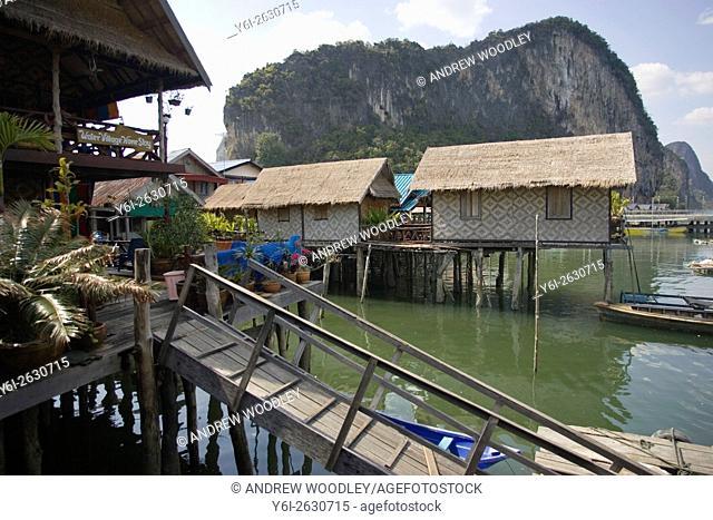 Ramps lead to Ko Panyi Muslim fishing village on stilts from floating pontoon docks Phang Nga Bay Thailand