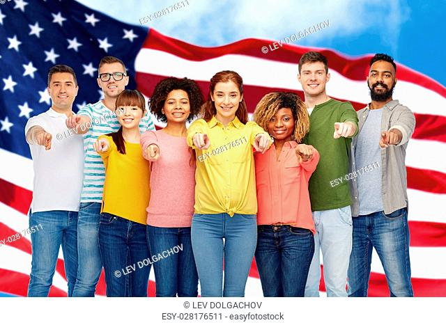 diversity, choice, ethnicity and people concept - international group of happy smiling men and women pointing finger on you over american flag background