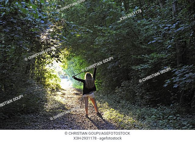 young girl on greenway, a former railway in Eure Valley, Eure-et-Loir department, Centre-Val de Loire region, France, Europe