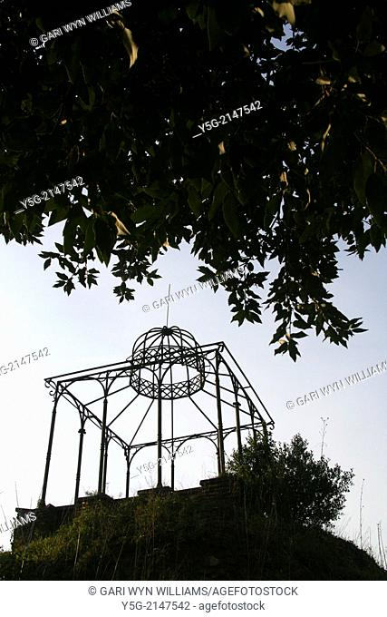 Metal garden gazebo type structure in a park in Rome Italy