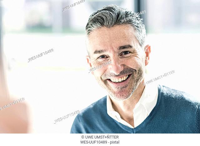 Portrait of happy businessman with stubble