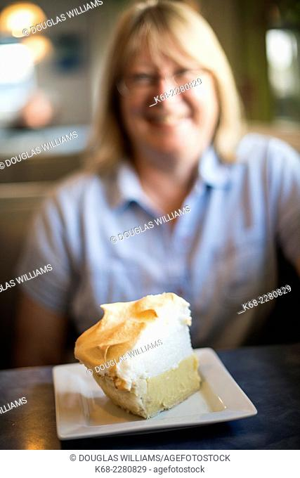 woman, 60, at a coffee shop