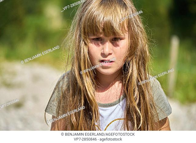 confident young female child in nature