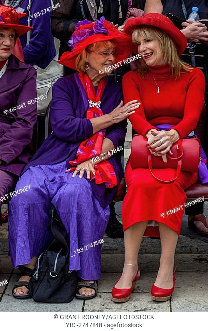 Two Women From The London Red Hatters Group Chatting At The Pearly Kings and Queens' Harvest Festival, Held Annually At The Guildhall Yard, London, England