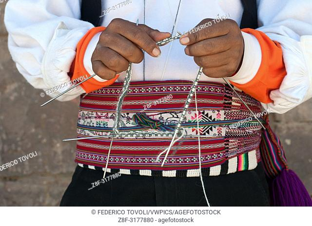 Although it is not a widespread habit, Taquile's men knit their own chullos. Peru