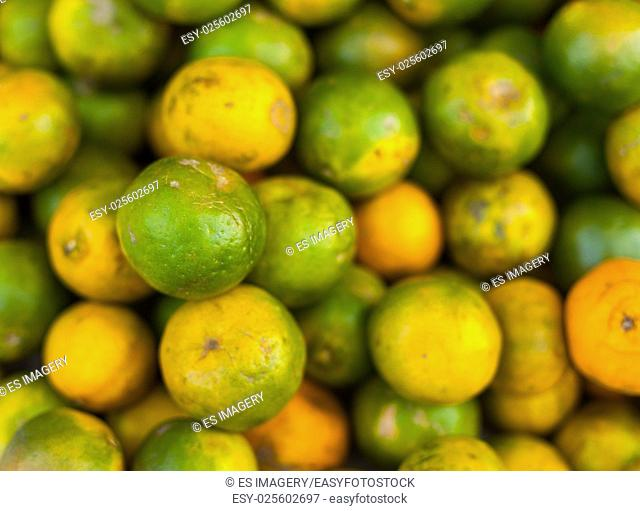 Green oranges on sale at a market, Nepal
