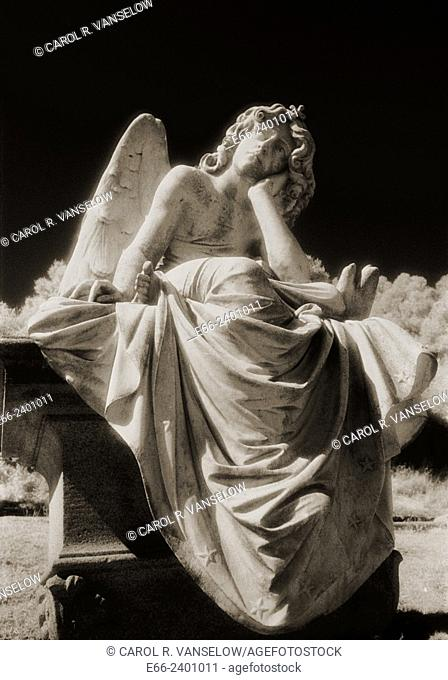 An angel waits / Black and white infrared shot of statue of angel in a cemetary