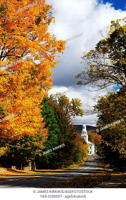 An autumn lane leads to a picturesque country church