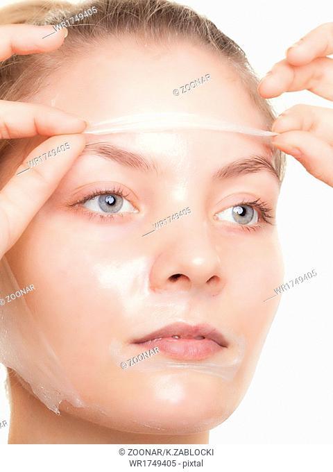 Girl woman in facial peel off mask. Skin care