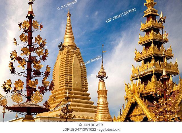 Myanmar, Mandalay, Bagan. The ornate spires and stupas of the Shwezigon Pagoda in Bagan in Myanmar