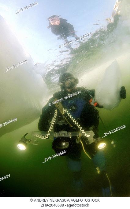 Diver, subglacial diving, ice diving, in the frozen Black Sea, a rare phenomenon, last time it occured in 1977, Odessa, Ukraine, Eastern Europe