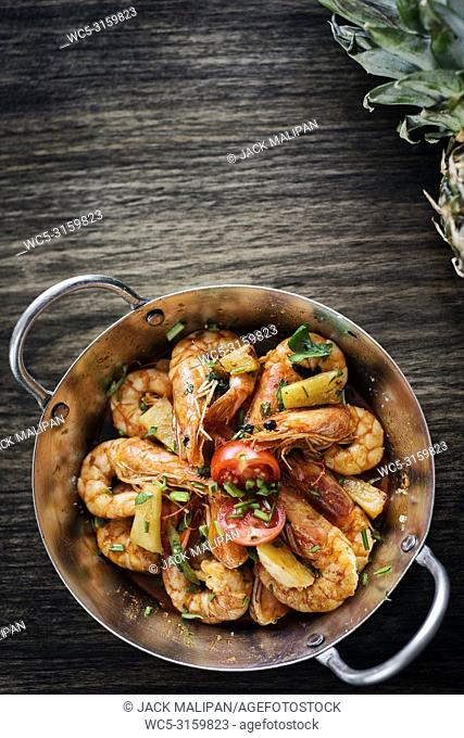 stir fry prawns in spicy asian food pineapple and herbs sauce