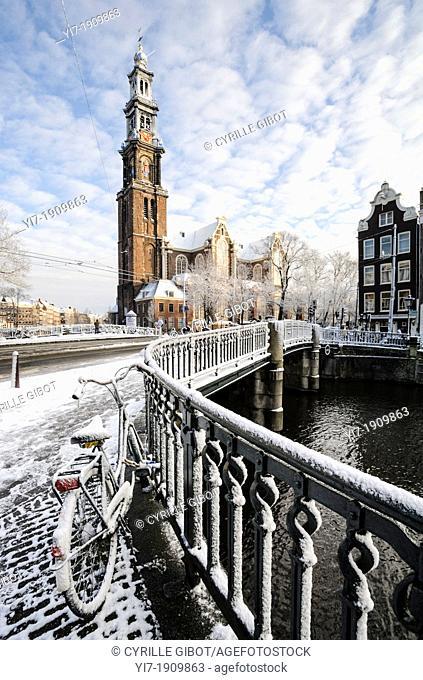 Amsterdam in winter. Westerkerk and bridge over Prinsengracht canal, Amsterdam, the Netherlands