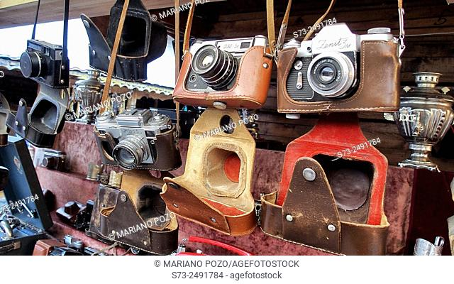 Old cameras in a street market. Moscow, Russia