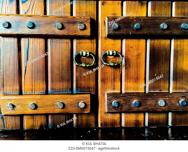 Cupboard door with iron hardware, Montreal, Canada