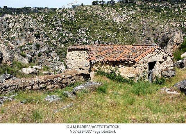 Popular architecture. Watermill (Molinos de la Ribera del Ponton) building with granite blocks. Villardiegua, Sayago, Zamora Province, Castilla-Leon, Spain