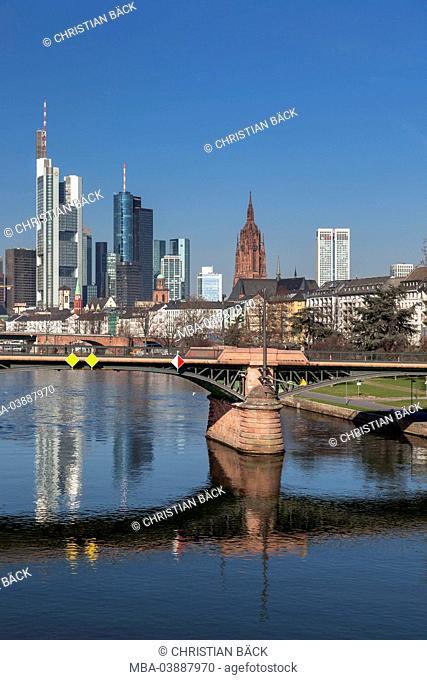 Frankfurt skyline seen from Flößerbrücke with Ignatz-Bubis-Bridge, Frankfurt on the Main, Hessen, Germany