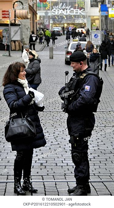 Heavily armed policemen patrol in Brno, Czech Republic, on Wednesday, December 21, 2016, after a truck ran into the crowded market on Monday and killed several...