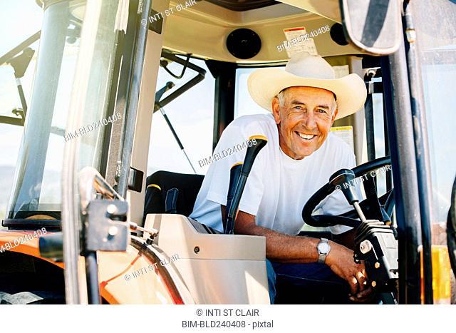 Portrait of smiling Caucasian farmer in tractor