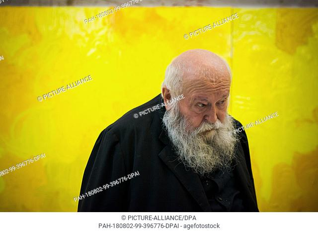 01 August 2018, Austria, Prinzendorf an der Zaya: The Austrian painter and action artist Hermann Nitsch stands in front of one of his blue works at his studio...