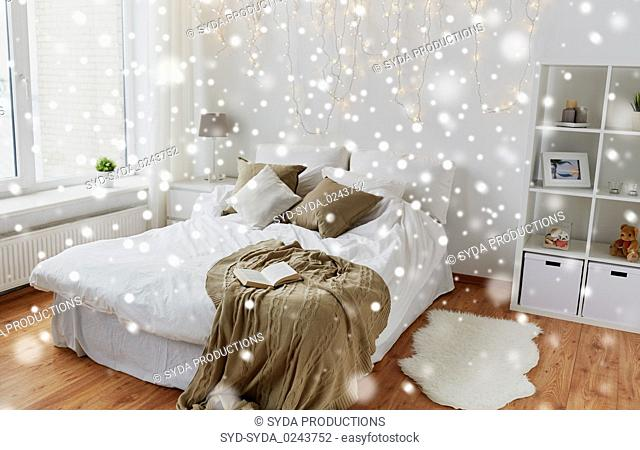bedroom with bed and christmas garland at home