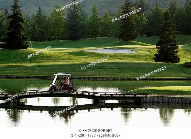 THE NANTILLY GOLF COURSE STRETCHES OUT AROUND PONDS DOMINATED BY TREE-FILLED HILLS, EURE-ET-LOIR 28, FRANCE