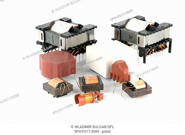 Ferrite electronic transformers against a white background