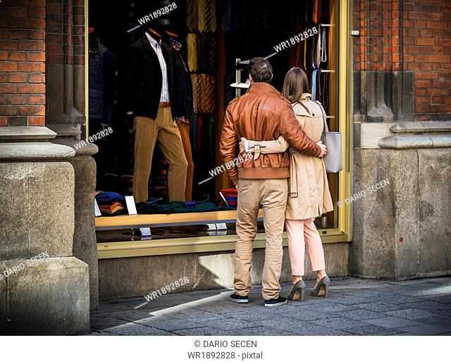 Young couple shopping, Marienplatz, Munich, Bavaria, Germany