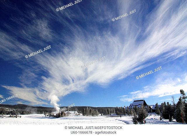 An Old Faithful geyser eruption produces a surreal sky during winter at Yellowstone National Park,Wyoming