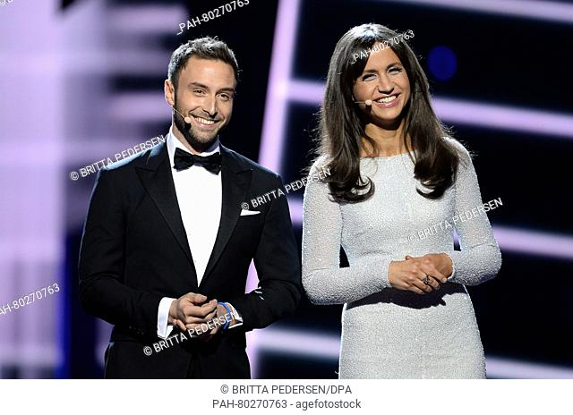 Swedish singer Mans Zelmerlow, winner of the Eurovision Song Contest 2015 and host of the 2016 contest, and Swedish co-host Petra Mede (R) are seen on stage...