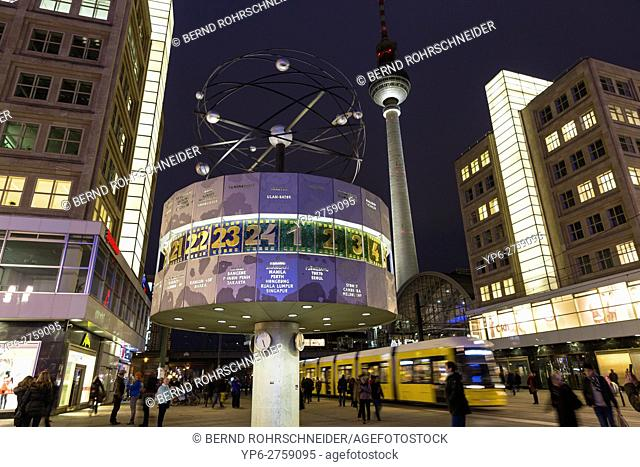 world clock and television tower at night, Alexanderplatz, Berlin, Germany