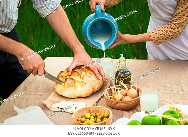 The picture of healthy natural food in the field. Family dinner. Concept of healthy way of life and rural life