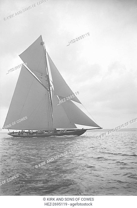 The 221 ton gaff-rigged cutter 'Britannia' sailing close-hauled, 1913. Creator: Kirk & Sons of Cowes