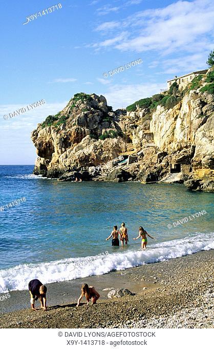 Mallorca Majorca Spain Balearic Islands  Children bathing on beach on the rugged north coast  Summer