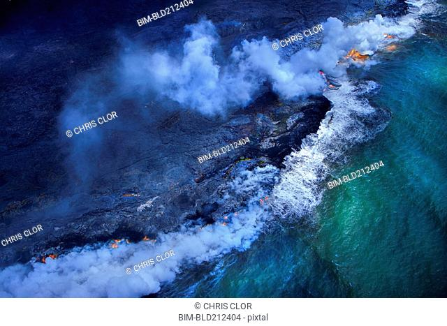 Aerial view of undersea volcanoes erupting