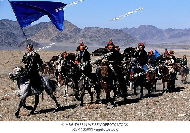 Kazakhs eagle hunters on their way the to the Golden Eagle Festival, Bayan Ölgii, Altai Mountains, Mongolia