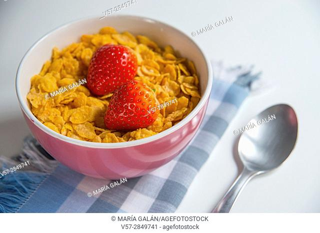Cereals with strawberries for breakfast. Close view