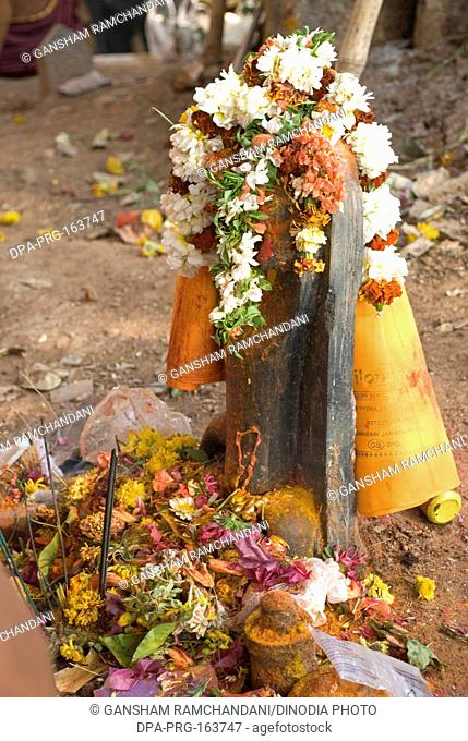 Shivalinga covered by garlands in mahashivaratri celebration at Keesaragutta ; Hyderabad ; Andhra Pradesh ; India NO PR