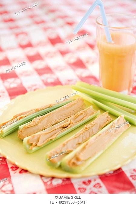 Celery and peanut butter on plate