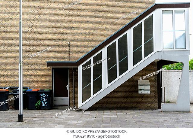 Tilburg, Netherlands. Elevating stairs towards the second floor of an 1960's designed apartment building