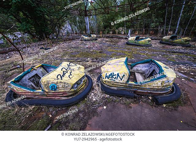 Bumper cars in amusement park of Pripyat ghost city, Chernobyl Nuclear Power Plant Zone of Alienation around nuclear reactor disaster in Ukraine