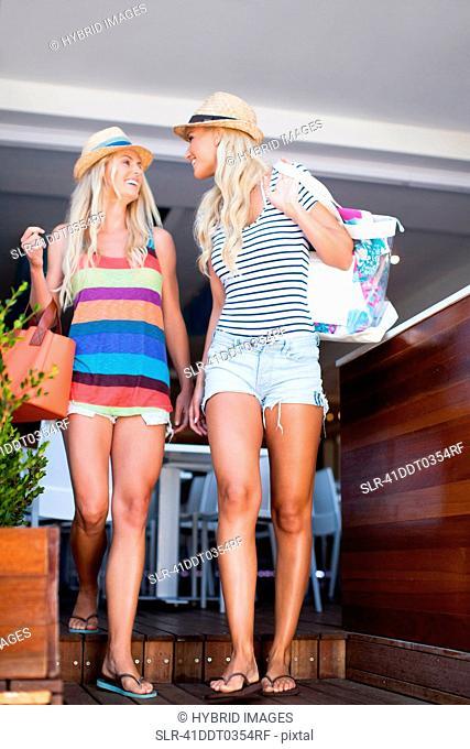 Women leaving cafe together
