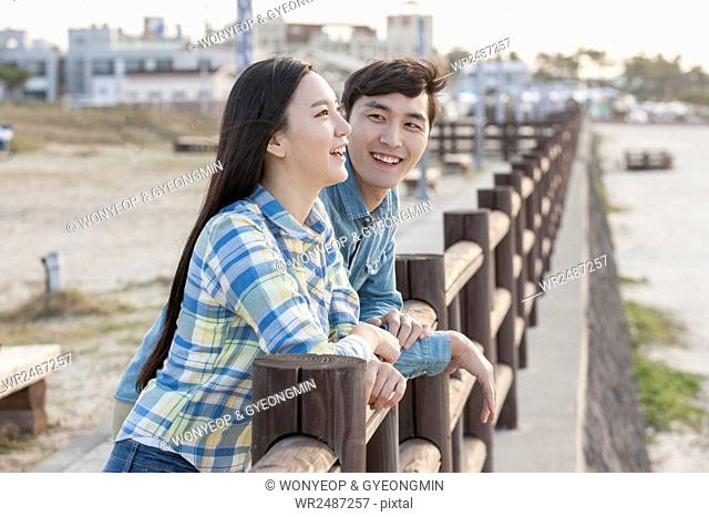 Side view portrait of young smiling couple