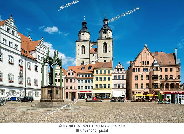 Market Square with Town Hall and Luther Monument, at back parish church St. Marien, Luther city Wittenberg, Saxony-Anhalt, Germany