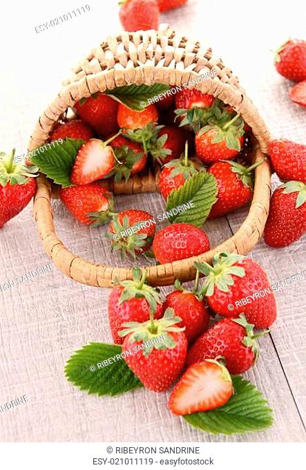 heap of strawberry and wicker basket