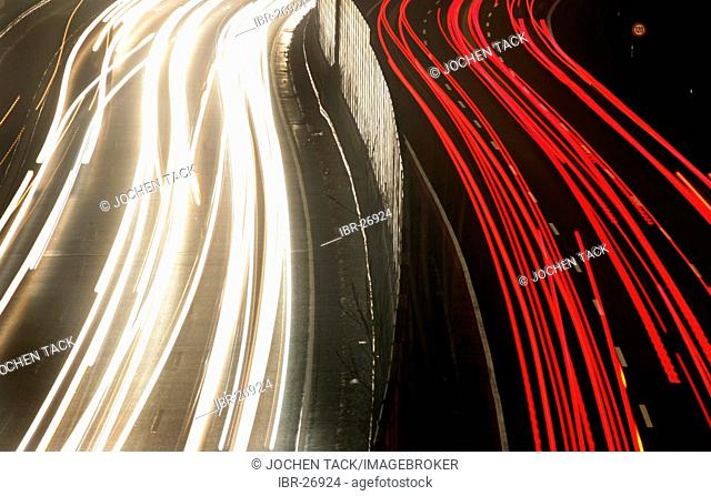 DEU, Germany : Essen, motorway Autobahn A52. Rushhour in the evening. Noise protection wall