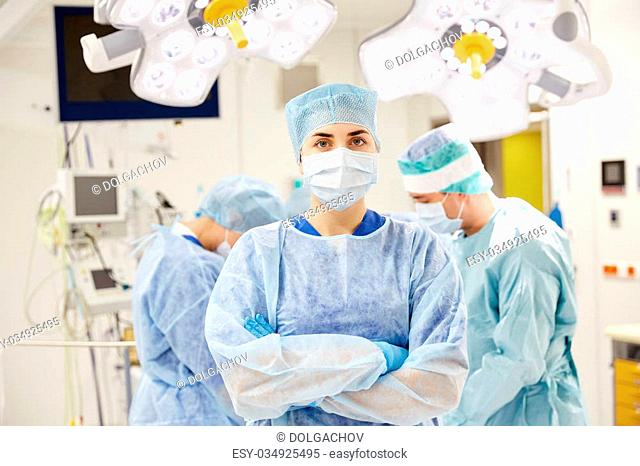 surgery, medicine and people concept - surgeon in operating room at hospital