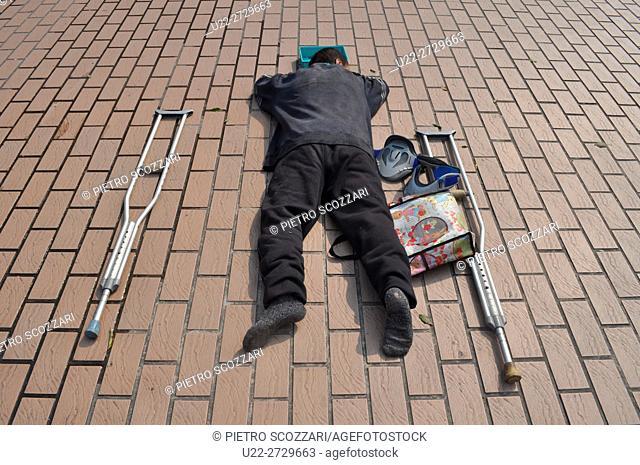 Taipei, Taiwan: beggar by Taipei Main Station