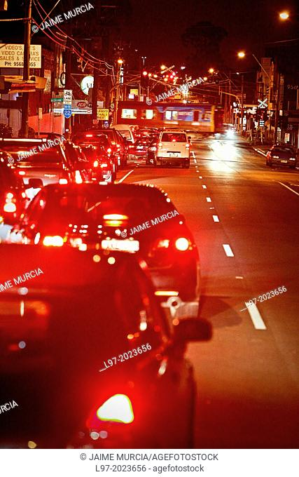 Traffic congestion at railway crossing, red tail lights of cars, Melbourne Australia